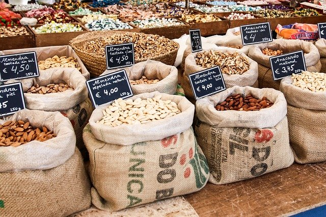 bags of nuts and almonds on a market